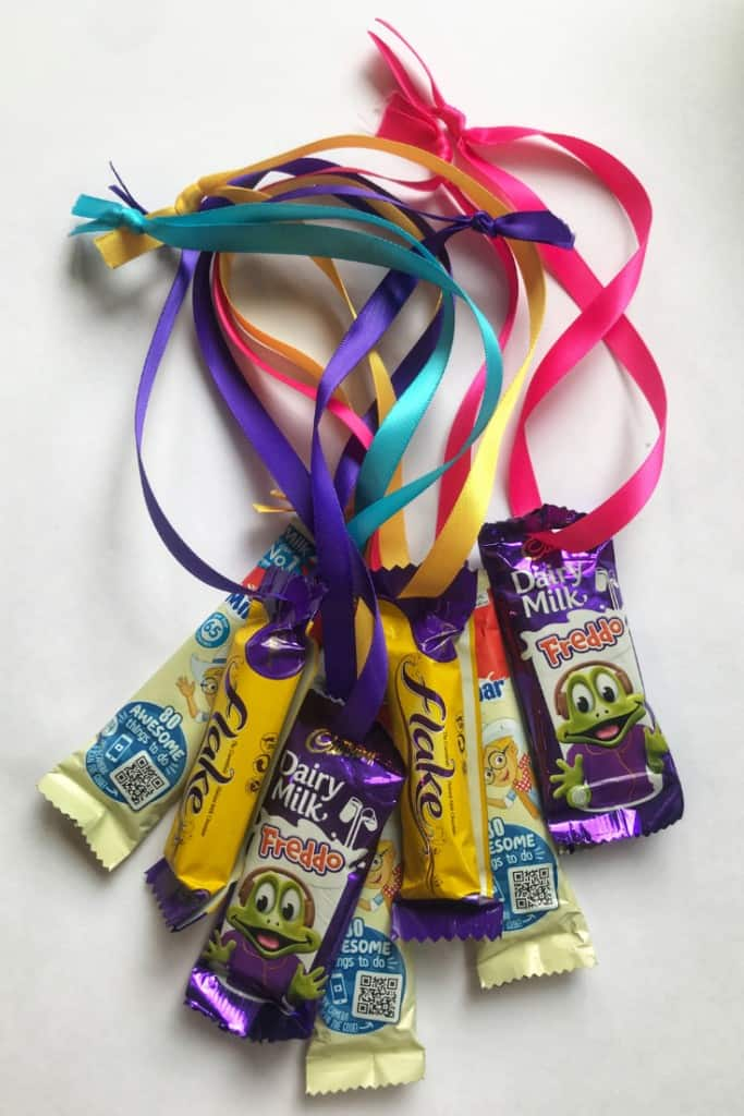 Party games need prizes and these chocolate medals are always winners in our house! East t& cheap make, get the kids to help you thread these ready for the big #partyideas #birthdaypartyideas #chocolatemedals #partyprizes #partyideas